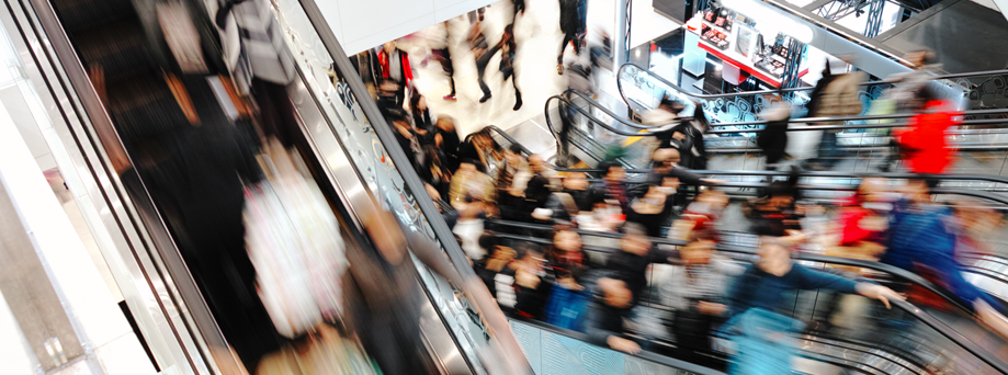 Shopping centre crowds on escalators
